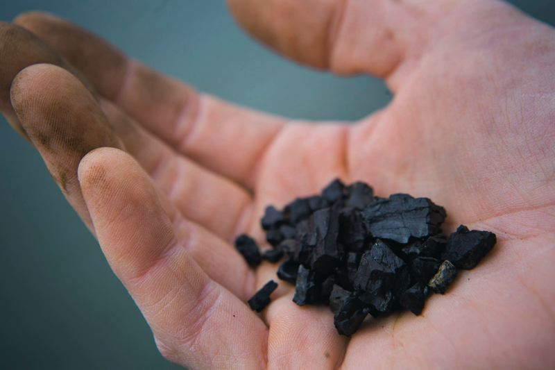 by: PAMPLIN MEDIA GROUP FILE PHOTO: CHRISTOPHER ONSTOTT - These chunks of coal from passing trains were picked up in the Columbia River Gorge where the White Salmon River drains into the Columbia. An EcoThoughts writer wonders just how much coal dust will settle in the Gorge if new coal export terminals are allowed in Northwest ports.