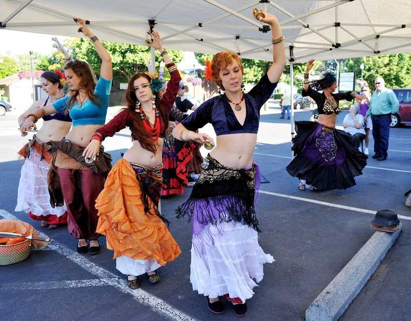 by: TIMES PHOTO: JOHN LARIVIERE - Members of the Mandala neo-tribal belly dance troupe perform outside Beaverton Florist during the downtown Beaverton First Friday event.
