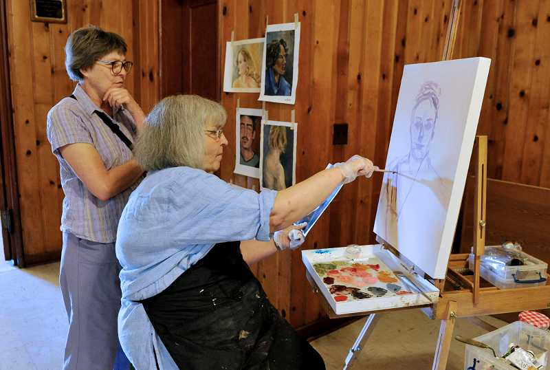 by: TIMES PHOTO: JOHN LARIVIERE - Artist Diane Mark-Bestor works on the foundation of a portrait in the Beaverton Masonic Lodge as Janet Gray looks on during First Friday festivities in downtown Beaverton.