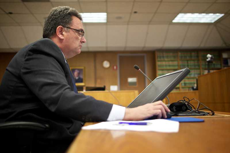 by: TIMES PHOTO: JAIME VALDEZ - City of Beaverton Prosecuting Attorney Tim Kempton follows the cases of participants in the Beaverton Sobriety Opportunity for Beginning Recovery, or B-SOBR impaired-driving diversion program.