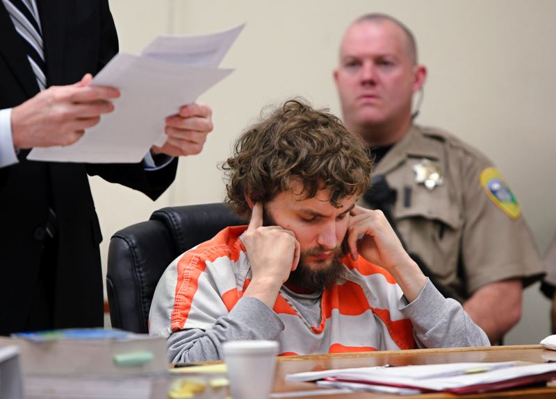 by: PHOTO COURTESY OF BILL WAGNER - Accused cop killer Daniel A. Butts kept his head down and, often, his fingers in his ears at an aid and assist hearing in March. Judge Ted Grove sent Butts back to the Oregon State Hospital for treatment.