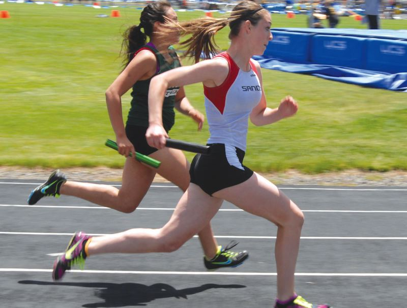 by: CONTRIBUTED PHOTO - Sandys Natalie Paul moves ahead of Astoria on the third leg of the winning 400-meter relay at the middle school state championship track meet.