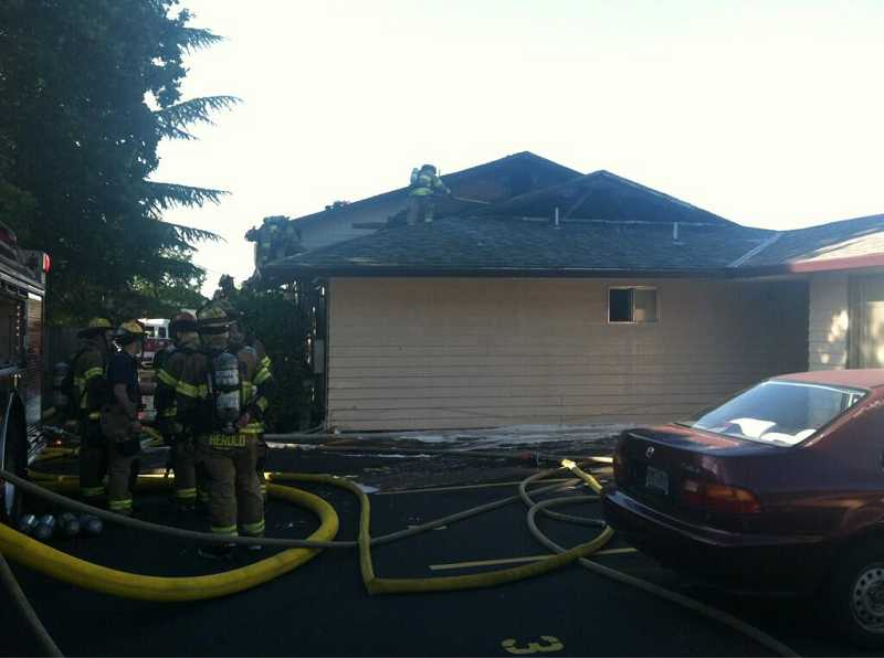 by: TVF&R - Fire crews extinguished an apartment fire at Canterbury Apartments, Friday evening