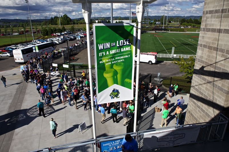 by: TRIBUNE PHOTO: JAIME VALDEZ - Baseball fans begin to pour into Hillsboro Ballpark to watch the Hops' home opener Monday night.