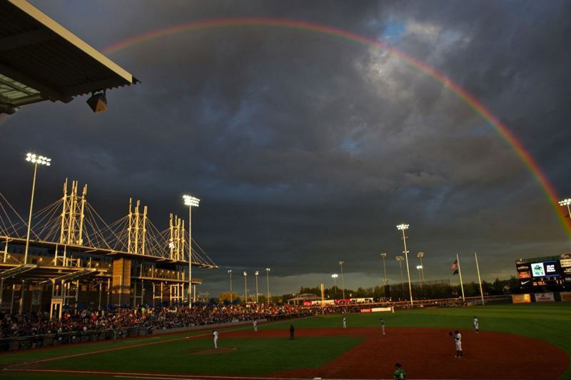 by: TRIBUNE PHOTO: JAIME VALDEZ - A rainbow appears over Hillsboro Ballpark during Monday night's home opener for the new Hillsboro Hops.