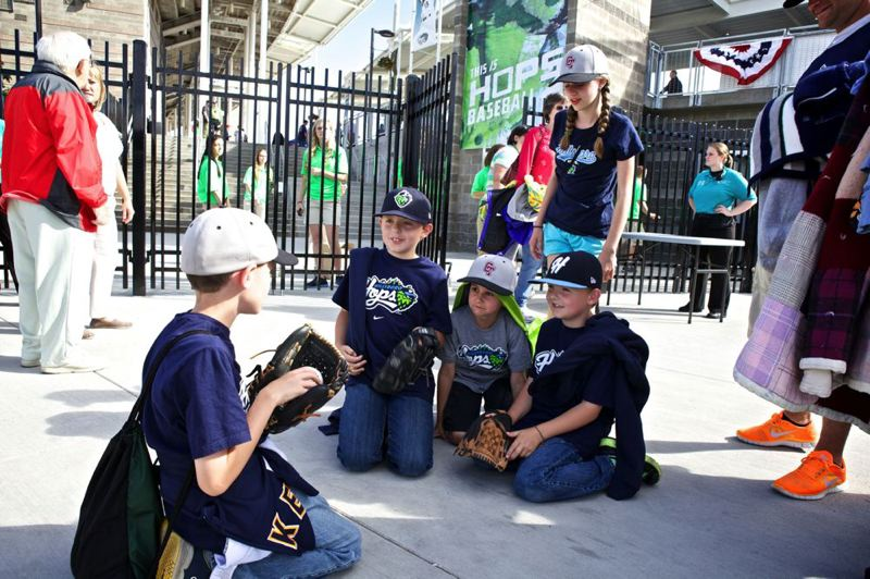 by: TRIBUNE PHOTO: JAIME VALDEZ - Waiting for the gates to open at Hillsboro Ballpark are (from left) Zack Bastinello, 9; Gavin Barackman, 9; Drew Bastinello, 7; and Cohen Barackman, 7; and (standing) Sadie Bastinelli.