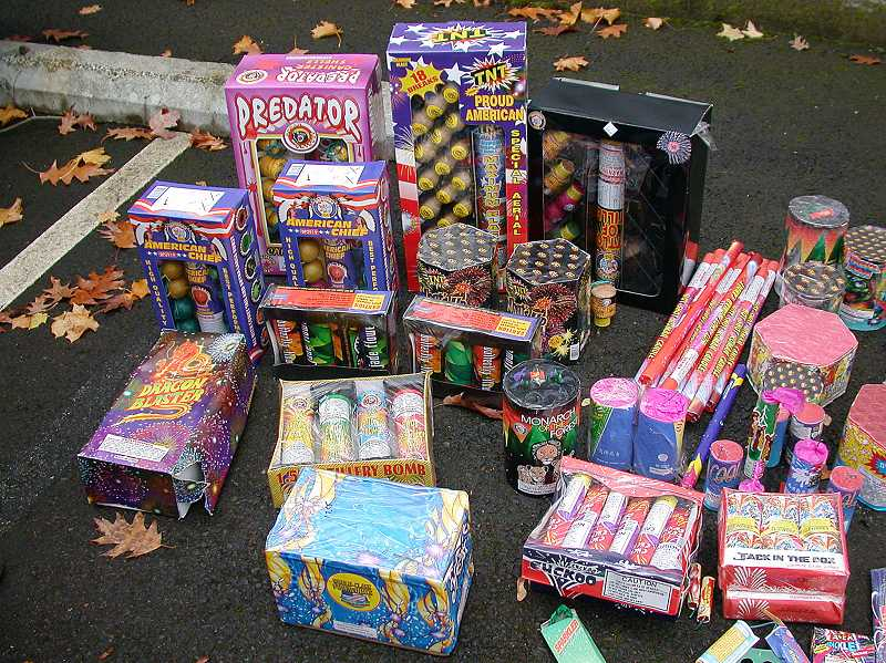 by: SUBMITTED - This pile of illegal fireworks was among items seized by the Lake Oswego Fire Department one summer. Fire officials and police officers plan to step up enforcement beyond confiscation and education to ticket illegal fireworks users this year.