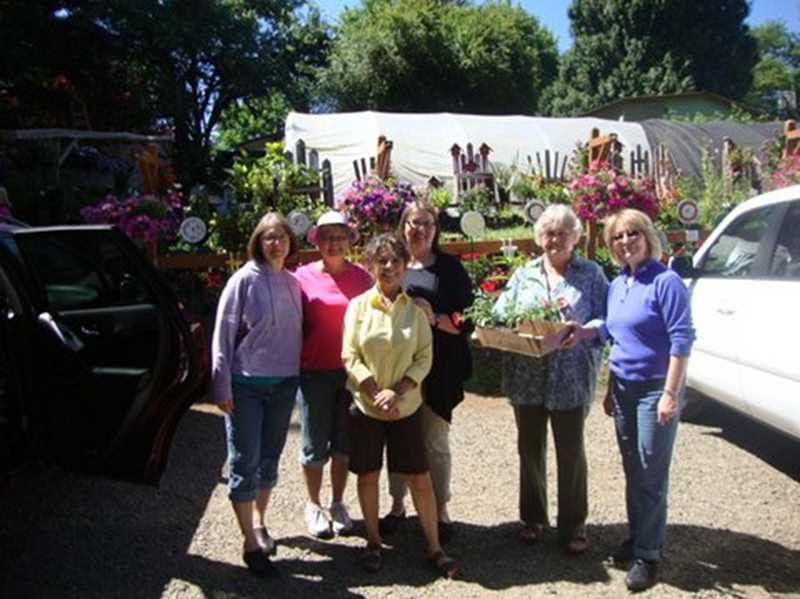 by: COURTESY PHOTO: BANKS GARDEN CLUB - The ladies of the Banks Country Garden Club frequent plant sales together.