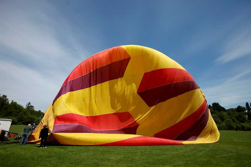 by: TIMES PHOTO: JONATHAN HOUSE - The Tigard Festival of Balloons returns to Cook Park starting Friday. Volunteer balloon chasers will turn out in droves for the festival to help set up and follow the hot-air balloons over the next three days.