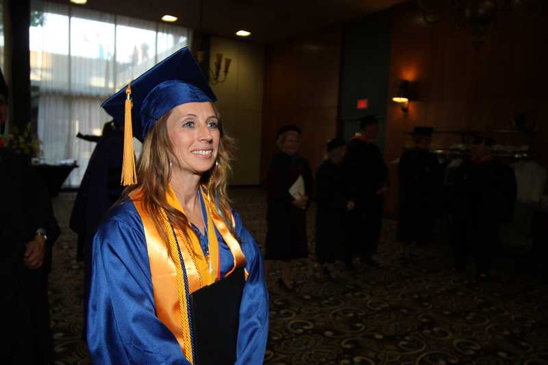 by: SUBMITTED PHOTO: JAMES HILL - 'Today, I am graduating with more than my degree, I'm graduating as a new person,' Michelle Reers tells a crowd of thousands gathered in Memorial Coliseum for PCC's graduation