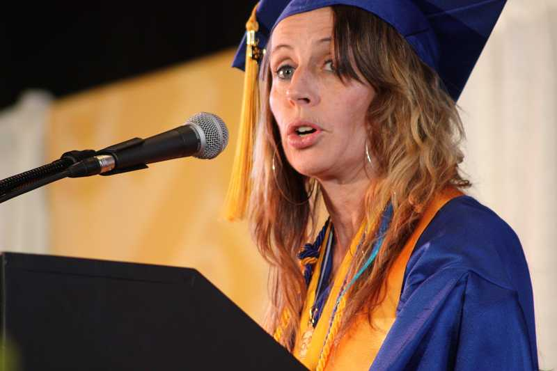 by: SUBMITTED PHOTO: JAMES HILL - Michelle Reers shares her story of how education changed the course of her life as the student speaker during Portland Community College's 51st commencement ceremony.