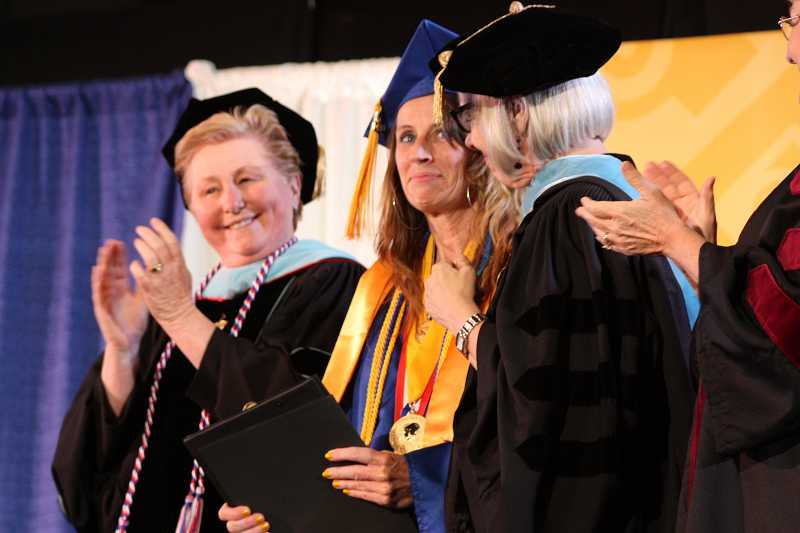 by: SUBMITTED PHOTO: JAMES HILL - Michelle Reers, center, shares the podium Friday with two of her mentors, Chris Chairsell, vice president of Academic and Student Affairs, and Linda Gerber, Sylvania Campus president.