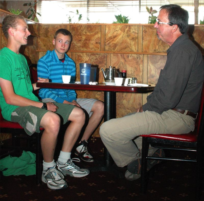 by: ISABEL GAUTSCHI - Estacada High School's 'If I were mayor' powerpoint winner, Josiah Shaver (left), lunches with his brother, Jehu Shaver, and Mayor Brent Dodrill at Wong's King Chinese Restaurant.