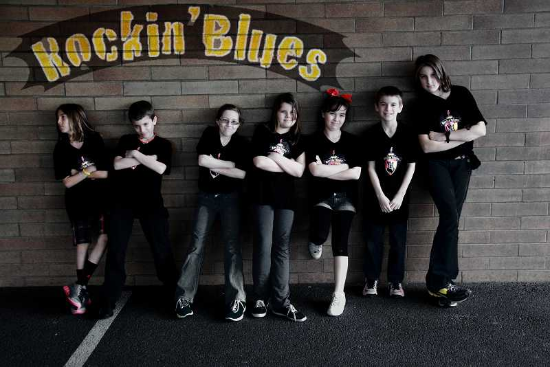 by: SUBMITTED PHOTO - The Rockin' Blues Academy was showcased by the musical talents of its seven-piece academy band comprised of former Oak Hills Elementary School fifth-graders Sumiran Sanock, Davis Efird, Madeline Jensen, Shaelie Messervier, Rachel Maclay, Taylor Efird and Grace Miller.
