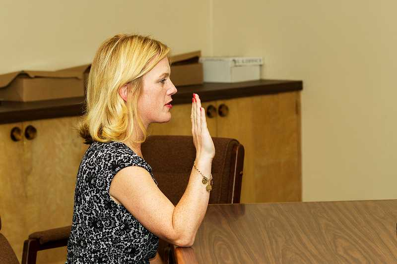 by: JIM HOWELL - New Lake Oswego School District board member Sarah Howell takes the oath of office on Monday.