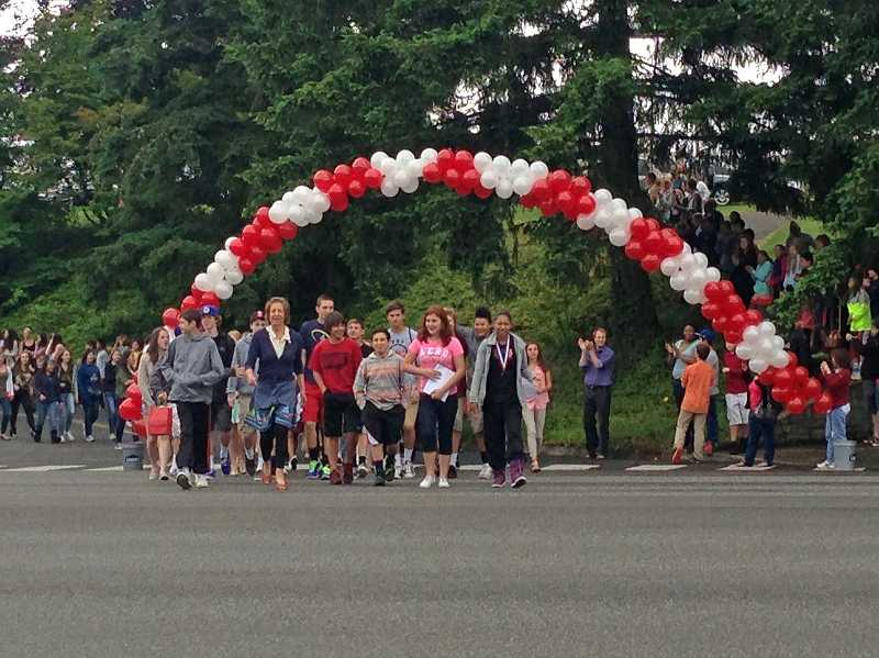 by: SUBMITTED PHOTO - LOJHS eighth graders, led by Principal Ann Gerson, participate in the annual Balloon Crossing.