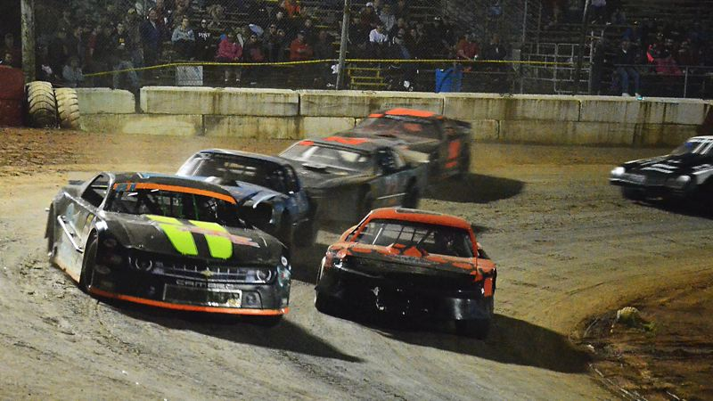 by: JOHN BREWINGTON - Ray Elwess leads the Sportsman Division main event race during Saturday's event. Bud Russell would come on to win the event with Elwess finishing third. Dan Smith was second. There were a good number of racers out for a pleasant evening Saturday.