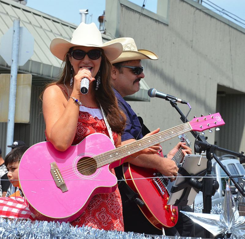by: JOHN BREWINGTON - Sweetwater's Jacqueline Roberts entertained down the parade route. The band will perform on the waterfront July 4 as part of '13 Nights on the River' and the annual fireworks display.