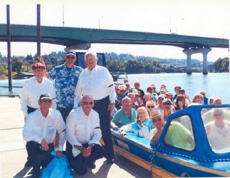 by: SUBMITTED PHOTO - Jerry Herrmann (bottom right) and The Tonesetters barbershop quartet pose next to one of the Willamette Jetboats that will be used for the upcoming Willamette River Discovery cruises.