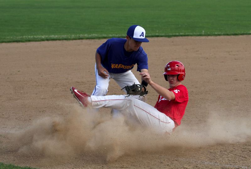 by: TIMES PHOTO: JONATHAN HOUSE - Alohas Mateo Melius puts the tag on a Lincoln runner during summer league play.