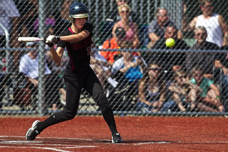by: JAIME VALDEZ - SENIOR SMACK -- Maddie Powelson, a 2013 Tualatin High School graduate shown here during play Monday at the Class 6A State-Metro All-Star Softball Series, shine both on the diamond and the volleyball court as a Timberwolf senior.