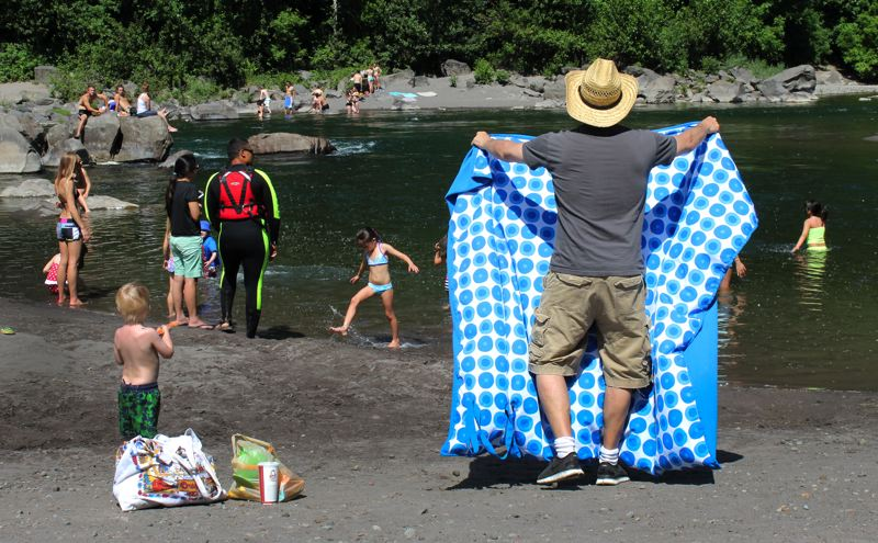 by: OUTLOOK PHOTO: CARI HACHMANN - Crowds take to the shores of the Sandy River in Troutdale.