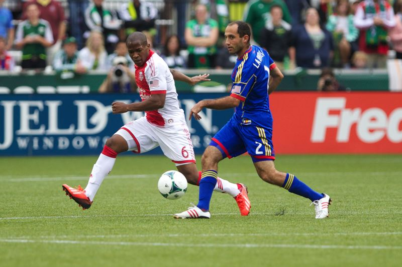 by: TRIBUNE PHOTO: JAIME VALDEZ - Portland Timbers forward/midfielder Darlington Nagbe (left) chases down the ball against Colorado Rapids midfielder Nick LaBrocca in the first half Sunday at Jeld-Wen Field.