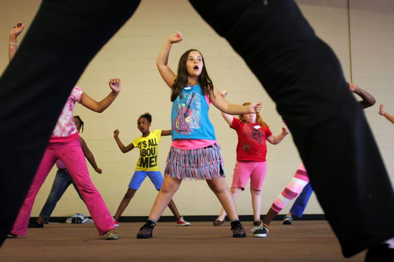 by: OUTLOOK PHOTO: JIM CLARK - Kassandra Pittman, 9, wore her special fringed skirt to her dance class, offered through The Aspire Project and the Rosewood Initiative.