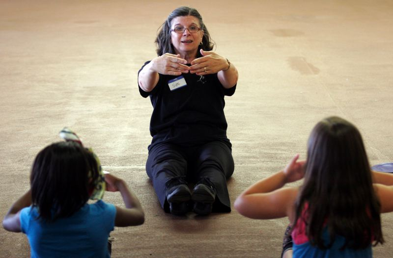 by: OUTLOOK PHOTO: JIM CLARK - Sue Darrow founded The Aspire Project to give underprivileged girls the opportunity to take dance classes that their families could otherwise not afford.