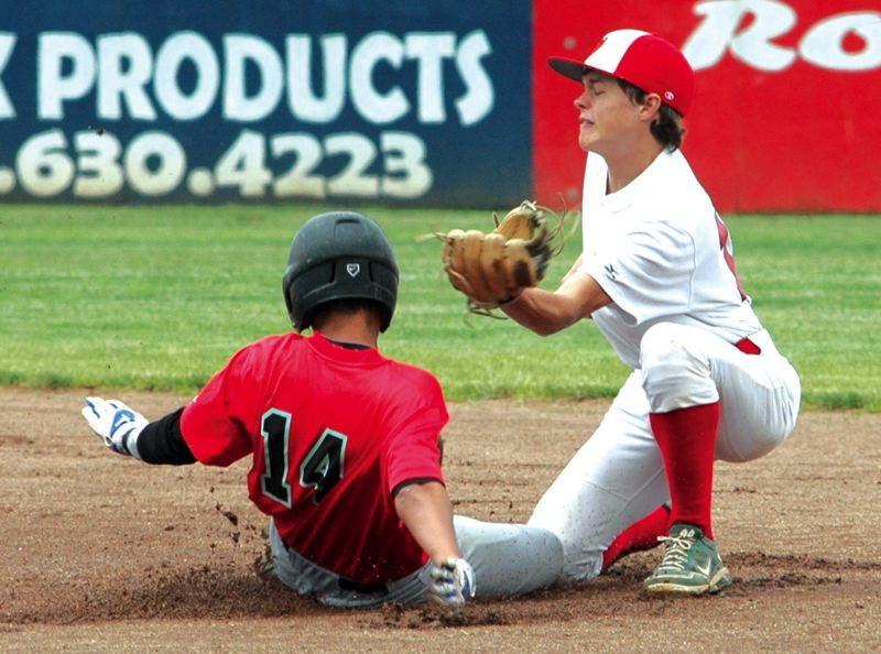 by: ESTACADA NEWS: PARKER LEE - Estacadas Zach Stamm tries for an out against Greshams Jaelen Bradley on a steal attempt at second base.