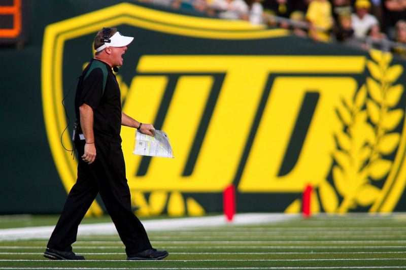 by: TRIBUNE FILE PHOTO: CHRISTOPHER ONSTOTT - Chip Kelly, as football coach of the Oregon Ducks, instilled a 'Win the Day' attitude.