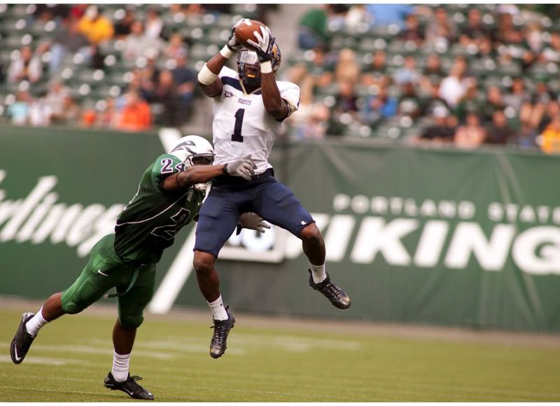 by: TRIBUNE FILE PHOTO: CHRISTOPHER ONSTOTT - Elvis Akpla, former Lincoln High receiver, makes a catch for Montana State in a 2011 game at Jeld-Wen Field against DeShawn Shead and the Portland State Vikings.