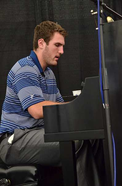 by: VERN UYETAKE - Pianist Alex Yeti entertains show goers in the Lakewood Center KeyBank Pavilion Tent.