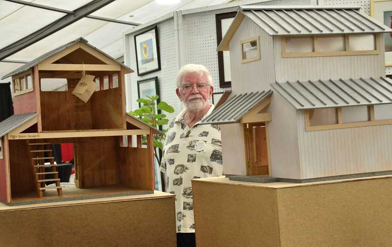 by: VERN UYETAKE - Bill Wright of Gresham admires the  farmhouses created by artist Patrick Hall at the open show exhibit.