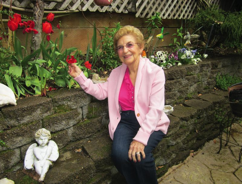 by: BARBARA SHERMAN - Joyce Saari continues to indulge in her passion for gardening at her King City home.