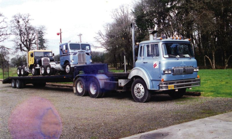 by: JOYCE SAARI - Three of the couples trucks are on the move in 1995.