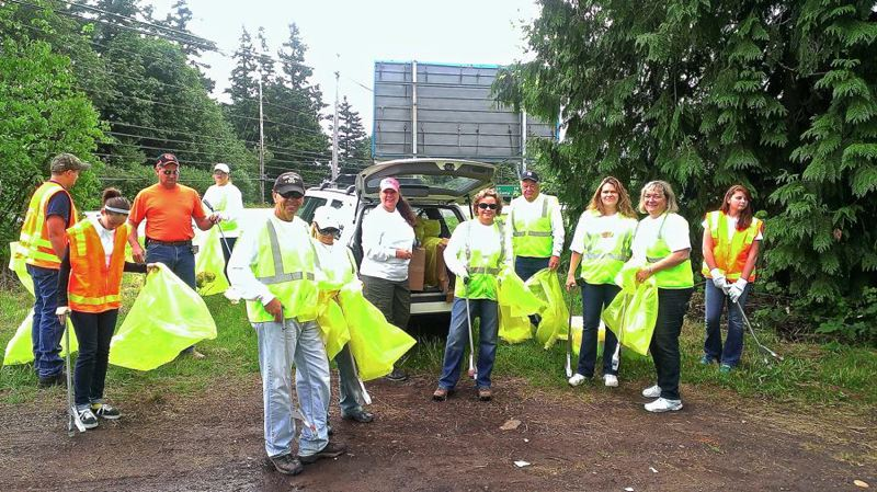 by: CONTRIBUTED PHOTO: CARL EXNER - Part of a group of Windermere employees and their family members are pictured just as they are ready to spread out along the boulevards and cross streets to help make the city look good for Mountain Festival visitors.