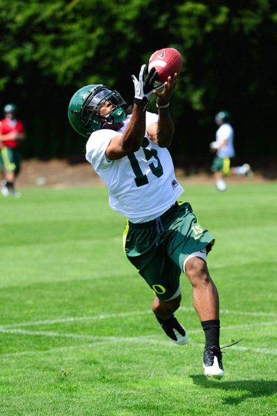 by: TRIBUNE FILE PHOTO: JEFFREY BASINGER - Lache Seastrunk, catching a pass in August 2010 Oregon Ducks training camp, came to Eugene after being mentored by scout Willie Lyles, whose relationship with players and the UO football program was investigated by the NCAA.