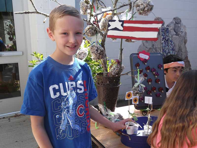 by:  KATE HOOTS - Jonah Adams, fourth grade, stands in front of his booth at the Stafford marketplace.