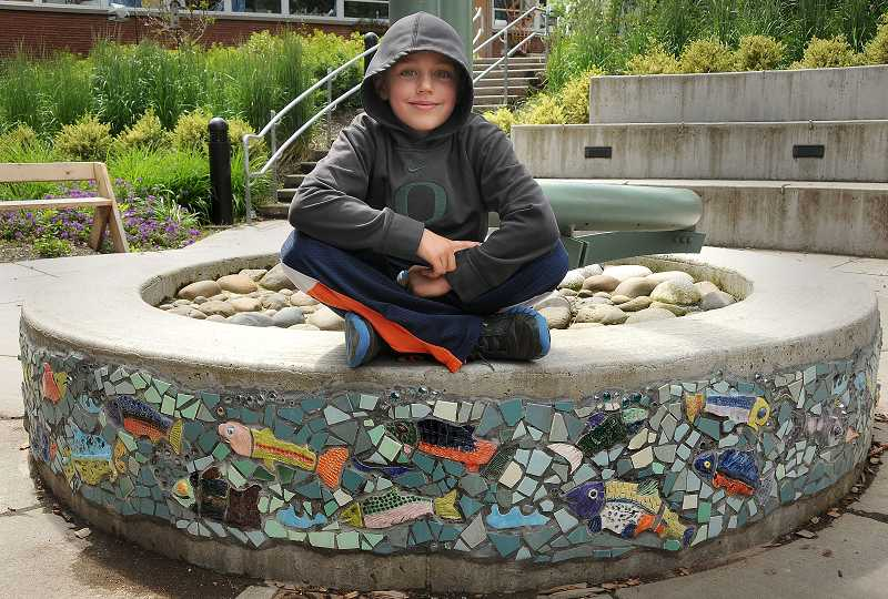 by: TIDINGS PHOTO: VERN UYETAKE - Jake Tawa's third-grade class made salmon to decorate the water catcher outside the school library.
