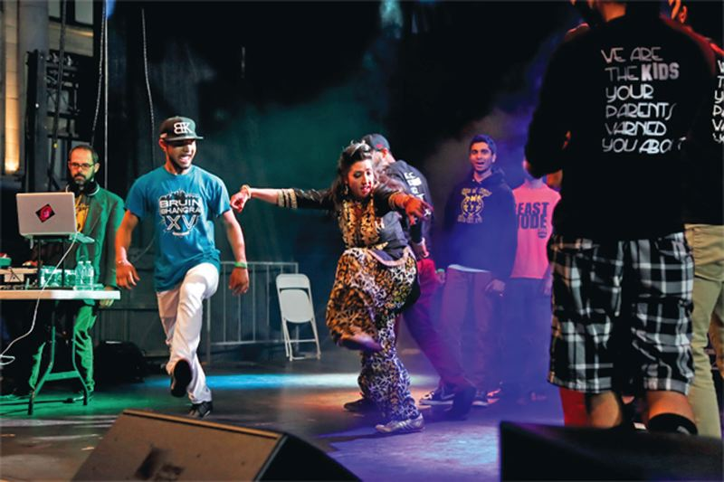 by: COURTESY OF VIBC - DJ Anjali of Portland joined bhangra dancers on stage at the recent Vancouver International Bhangra Celebration.