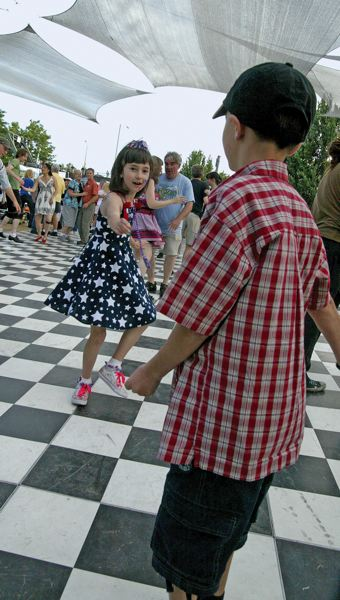 by: TRIBUNE FILE PHOTO: KEVIN HARDEN - A couple of youngsters dance at the front porch stage at a recent Waterfront Blues Festival. Thousands of folks will gather for the popular event, July 4 to 7.