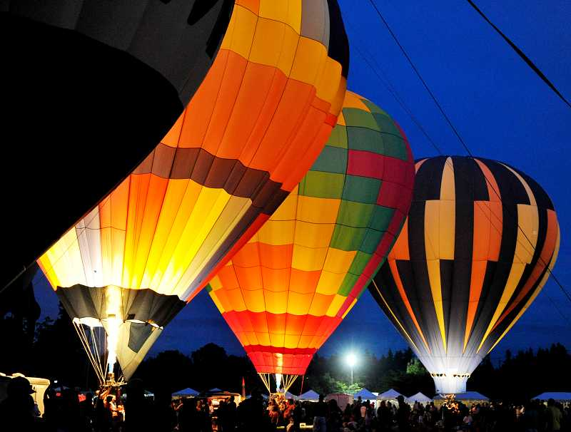 by: TIMES PHOTO: JOHN LARIVIERE. - Balloons light up the evening with the festival's annual Night Glow.