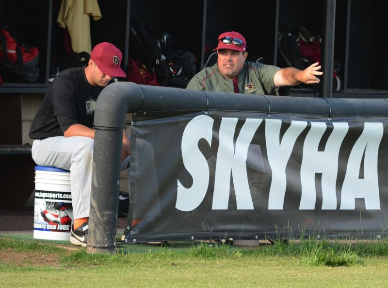 by: TIMES PHOTO: MATT SINGLEDECKER - Southridge baseball coach Joe Monahan believes baseball is a life teaching tool for his players and coaches them not just about the game but life as well.