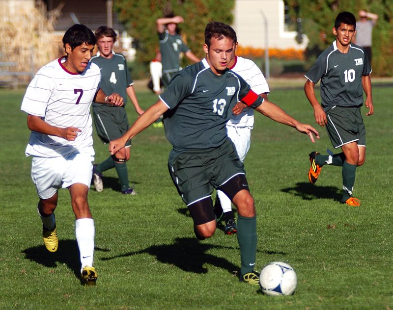 by: DAN BROOD - THE CAPTAIN -- Brian Josephson served as team captain for the Tigard High School boys soccer team.