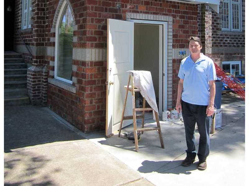 by: BARBARA SHERMAN - St. Paul Lutheran Church Pastor Don Richard on June 4 stands by a new addition housing an elevator, which was a few weeks before the elevator was expected to be up and running to transport people between the two floors of the 1930 church.