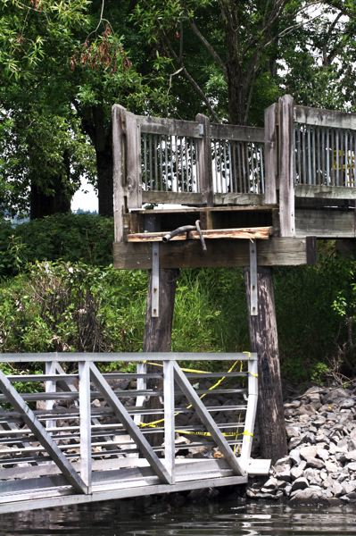by: OUTLOOK PHOTO: JIM CLARK - A gangway broke from a wooden walkway on shore at Chinook Landing.