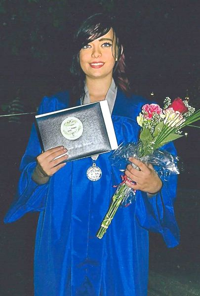 by: CONTRIBUTED PHOTO - Lydia Palmquist graduated Thursday, June 13, from Gresham High School, 100 years after her great-grandfather, Raymond Albert Palmquist.