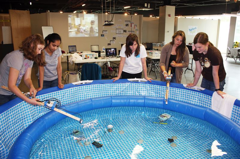 by: HILLSBORO TRIBUNE PHOTO: DOUG BURKHARDT - A group of five tech-savvy girls built underwater robots that moved by remote control in a pool set up at the Washington County Museum last week. The girls were part of the museums first annual Science, Technology, Engineering & Math Leadership Academy. Left to right are: Marina Odegaard, a home schooler; Alisha Menon of Oregon Connections Academy; Claire Edington of Glencoe High School; Nicole Hill of Sherwood Middle School; and Allison Drennen of Liberty High School.