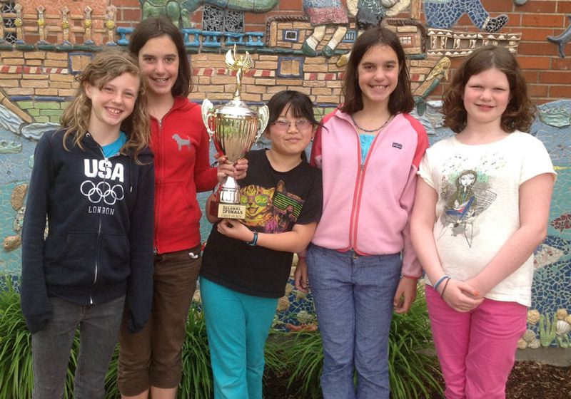 by: SUBMITTED PHOTO: PORTLAND PUBLIC SCHOOLS - Bridlemile's winning Destination Imagination team, the Fiverbolts, with their trophy.